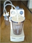 Suction machine, electrical, with 1 bottle, autoclavable